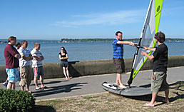 A beginners windsurfing course in progress at the Poole Windsurfing school
